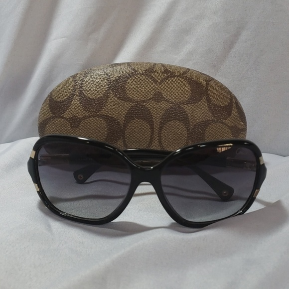 64ace22791 Black and gold coach sunglasses